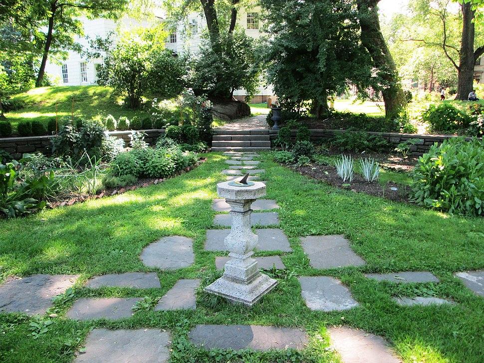 Roger Morris Park garden with sundial
