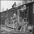 Rohwer Relocation Center, McGehee, Arkansas. Adding a front porch to their barracks, these centerit . . . - NARA - 538931.tif