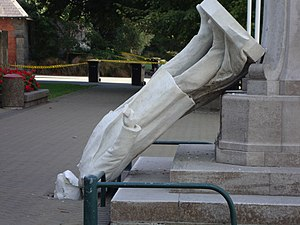Rolleston Statue - Toppled statue with the head broken off