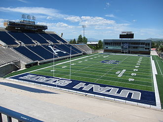 Maverik Stadium - The field and stadium in 2013 after upgrades to the turf and introduction of new logos. The Laub Athletics-Academics Complex in visible in the far end zone.