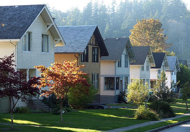 Evening sunlight streams through the row housing of Cedar street in Powell River. Row housing in the evening light on Cedar St. in Powell River, British is typical example of a residential area of a company built town from the early 20th century.