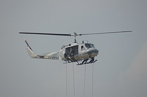 Royal Thai Air Force special operation troops rope out from UH-1.jpg
