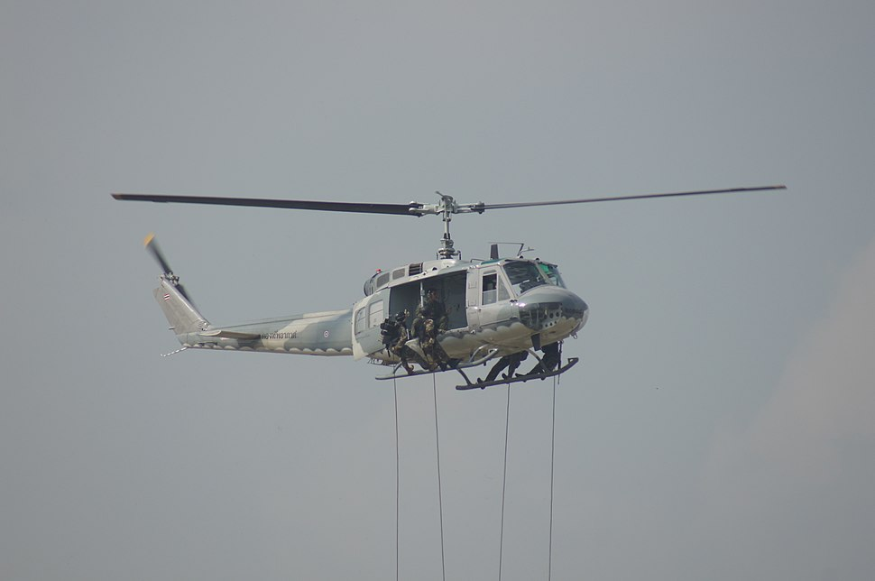 Royal Thai Air Force special operation troops rope out from UH-1