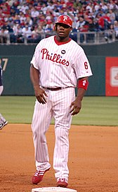 Ryan Howard wearing the current Phillies' white home uniform with red pinstripes and the Harry Kalas patch in 2009