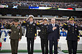 SECNAV and the CNO render honors during the national anthem..jpg