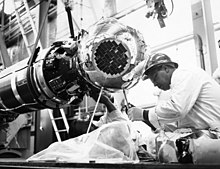 An engineer from Ling-Tempco-Vought makes final adjustments to a SECOR Satellite