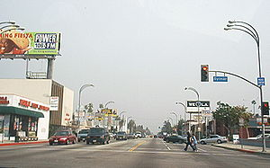Victory Boulevard in Van Nuys, lined with low-rise commercial establishments, is typical of the broad, straight boulevards in the San Fernando Valley. Photo, 2002. SFValley.jpg