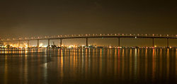 The Coronado Bridge at night. The bridge was built high enough to allow ships to navigate under.