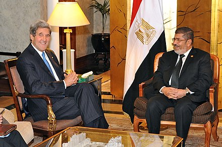 Then-U.S. Secretary of State John Kerry meeting with then-Egyptian President Mohamed Morsi, May 2013 Secretary Kerry Meets With Egyptian President Morsy in Addis Ababa (2).jpg