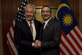 Secretary of Defense Chuck Hagel shakes hands with Malaysian Minister of Defense Hishammuddin Hussein.jpg
