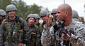 Sgt. 1st Class Garrett Williams demonstrates to Indian Army paratroopers how to use an M4 carbine.jpg