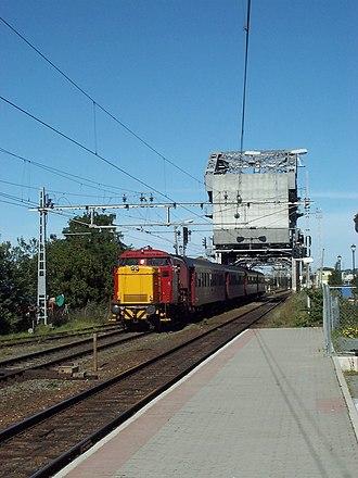 NSB Di 2 - Di 2 hauling a train over Skansen Bridge just south of Trondheim Central Station in 2000