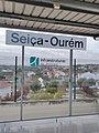 Sign for Seiça-Ourém and the view towards Outeiro in Seiça.jpg
