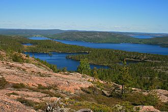 Skuleskogen National Park - View from Slåttdalsberget. One can see clearly in the foreground the characteristic color of the granite of Nordingrå.