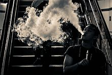 E-cigarette user blowing a large cloud of aerosol (vapor). This activity is known as cloud-chasing.
