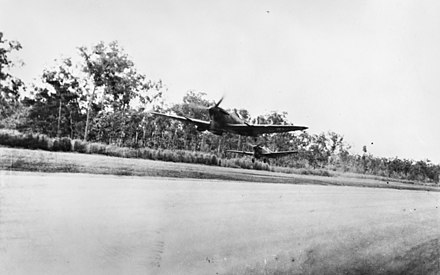 Two Australian Supermarine Spitfire fighters taking off from Darwin to intercept Japanese raiders in March 1943 Spitfires Darwin (AWM 014484).jpg