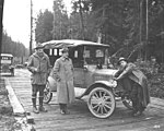 Spruce Division soldiers and Model T Ford with puppy on hood, ca 1918 (KINSEY 758).jpeg