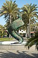 Statue of man on a serpent Maspalomas.jpg