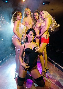 A group of women, some topless, in a Mexican strip club