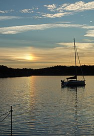 Sun dog with reflection and sailboat at Brofjorden.jpg