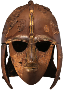 Colour photograph of the Sutton Hoo helmet, which has boar images on each of its two eyebrows