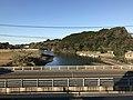 Tatsuogawa River and Tatsuobashi Bridge from train near Mikuriya Station.jpg