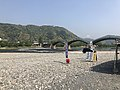 Tenshu of Iwakuni Castle and Kintaikyo Bridge from bed of Nishikigawa River 4.jpg