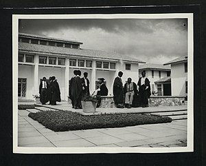 Education in Ghana - January 1957: students with a senior tutor outside Legon Hall, one of the Halls of Residence at the University College of the Gold Coast, near Accra