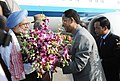 The Prime Minister, Dr. Manmohan Singh being welcomed by the Chief Minister of Assam, Shri Tarun Gogoi, on his arrival, at Guwahati Airport on February 18, 2011.jpg