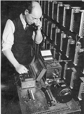 Telecommunications engineering - Telecommunications engineer working to maintain London's phone service during World War 2, January 1942