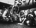 "These F-84 ""thunderjet"" pilots study a map of proposed enemy targets prior to taking off from their Korean airstrip to deliver their destructive ordnance to the communists in North Korea HF-SN-98-07486.jpg"