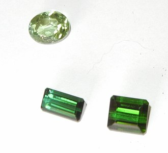 Tourmaline - Two dark green rectangular tourmaline stones and one oval tourmaline stone.