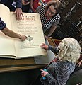 Touching book at Osler History of Medicine Library.jpg
