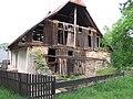 Tužín, rozpadající se dům.jpg