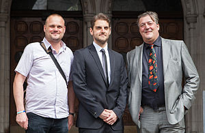 Twitter Joke Trial - Chambers (centre), with Al Murray (left) and Stephen Fry (right) outside the High Court on 27 June 2012
