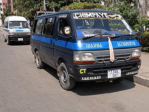 Two dala dalas (minibuses) in Mwanza
