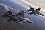 U.S. Air Force F-16 Aggressor aircraft fly over the Joint Pacific Alaska Range Complex Oct. 8, 2009, during Red Flag-Alaska.jpg