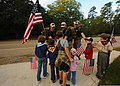 U.S. Air Force Staff Sgt. Danny Wright, Senior Airman Jordan Delbohm and Airman 1st Class Keith Thompson greet members of Cub Scout Pack 221 during the Tim Davis Memorial March in Madisonville, La., Oct. 23 111023-F-PV498-050.jpg