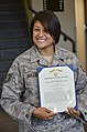 U.S. Air Force Tech. Sgt. Yvette Orellana, with the 12th Air Force, smiles after receiving an Air Force Commendation medal at Davis-Monthan Air Force Base, Ariz., Sept 130920-F-HZ705-023.jpg