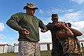 U.S. Marine Corps Gunnery Sgt. Herman Marquez, left, a nonlethal weapons instructor with the with 3rd Law Enforcement Battalion, III Marine Expeditionary Force, demonstrates as Mongolian Armed Forces Sgt. G 130820-M-MG222-005.jpg