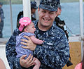 U.S. Navy Electrician's Mate 2nd Class Huston Roof, assigned to the attack submarine USS Chicago (SSN 721), reunites with his family at Apra Harbor, Guam, April 25, 2013 130425-N-LS794-423.jpg