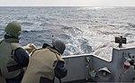 U.S. Navy Gunner's Mate Seaman Robert Greene, right, fires an M240B machine gun during a live-fire exercise aboard the amphibious transport dock ship USS Denver (LPD 9) March 10, 2014, in the East China Sea 140310-N-IC565-532.jpg