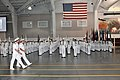 U.S. Navy Rear Adm. Clifford S. Sharpe, second row, former commander of Naval Service Training Command, walks the line with Capt. John T. Dye, commanding officer of Recruit Training Command, during the weekly 120928-N-IK959-547.jpg