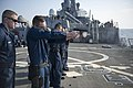 U.S. Sailors fire 9 mm pistols during a small-arms qualification aboard the guided missile destroyer USS Stout (DDG 55) Jan. 18, 2014, in the Mediterranean Sea 140118-N-UD469-163.jpg