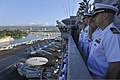 U.S. Sailors render honors aboard the aircraft carrier USS Nimitz (CVN 68) as the ship passes the Battleship Missouri Memorial while arriving at Joint Base Pearl Harbor-Hickam, Hawaii, Dec. 3, 2013 131203-N-UV347-315.jpg