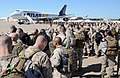 U.S. Service members at Fort Worth, Texas, board an airplane bound for Agadir, Morocco, April 5, 2012, in support of African Lion 2012 120405-A-JC300-094.jpg