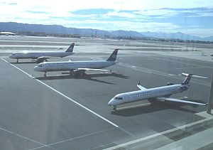 Bombardier CRJ - A US Airways Express Bombardier aircraft (bottom right) along with two Airbus A321 of US Airways at Phoenix Sky Harbor International Airport on January 27, 2015.