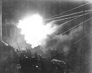 USS Boise (CL-47) shelling the coast of New Guinea in early 1944 (80-G-213844)