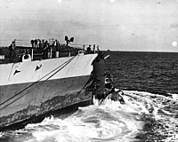 USS Washington at sea with collision damage