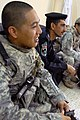 US Army 51935 TAJI, Iraq- Little Rock, Ark. Native, Capt. Alex Aquino, commander of Battery B, 1st Battalion, 82nd Field Artillery Regiment, and Hamamiyat Federal Police Station commander, Maj. Thamir, listen as th.jpg